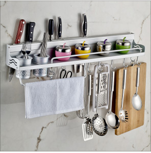 Use your walls to hang up racks or pegs to keep favorite utensils, pot  holders